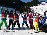 Childres´s group with ski instructor Mariella